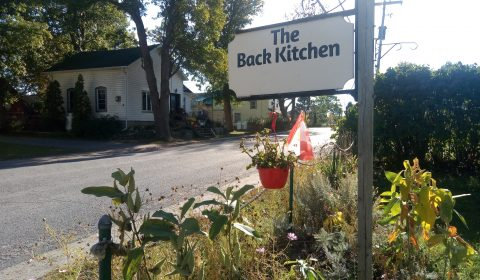 the back kitchen sign